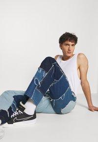 Jaded London - PATCHWORK SKATE - Straight leg jeans - blue - 3
