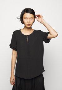 Bruuns Bazaar - CAMILLA SIKE  - Blouse - black - 3
