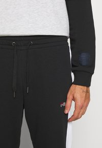 Fila - LARS  - Tracksuit bottoms - black/bright white - 4