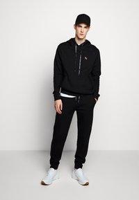 Raeburn - Pantaloni sportivi - black - 1