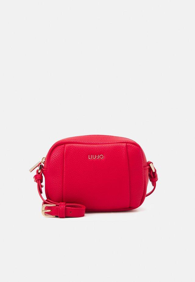 BEAUTY - Across body bag - true red