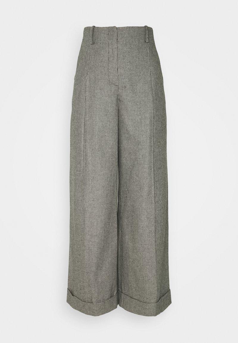 sandro - COUREY - Trousers - noir / blanc