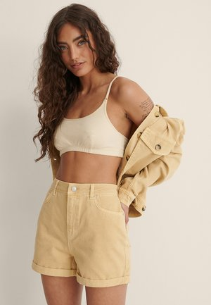 COLORED TURN UP - Denim shorts - dusty yellow