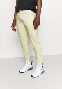 Nike Golf - SLIM PANT - Kangashousut - lemon drop - 0