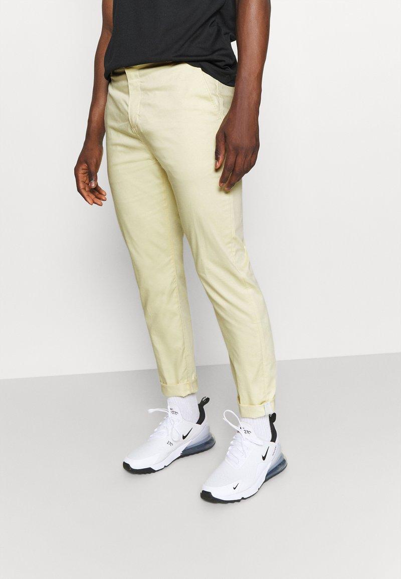 Nike Golf - SLIM PANT - Kangashousut - lemon drop