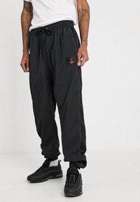 Jordan - FLIGHT WARM UP PANT - Tracksuit bottoms - black - 0