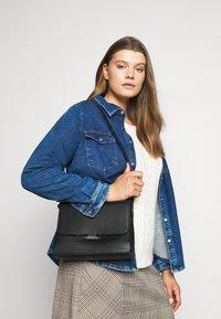 Calvin Klein - RETRO SHOULDER BAG - Torba na ramię - black - 0