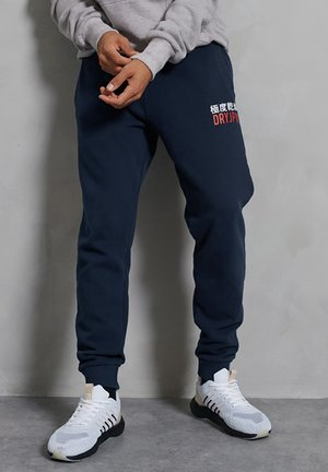 PANEL JOGGERS - Tracksuit bottoms - rich navy