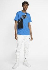 Nike Sportswear - CLUB - Tracksuit bottoms - white/white/black - 1