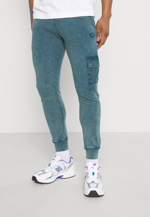 ESSENTIAL UTILITY - Tracksuit bottoms - marine blue
