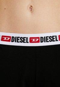 Diesel - SHAN SHORTS - Spodnie od piżamy - black - 4