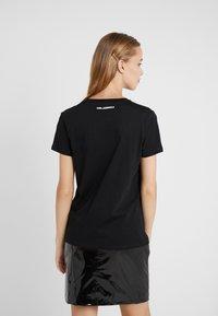 KARL LAGERFELD - CHOUPETTE - T-shirts med print - black - 2