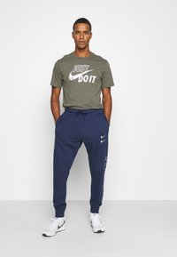 Nike Sportswear - PANT - Tracksuit bottoms - midnight navy/silver - 1