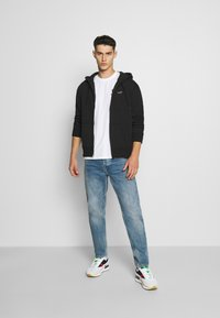 Hollister Co. - GENDERLESS ICON - Hoodie met rits - black - 1