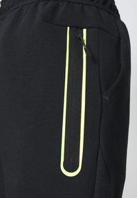 Nike Sportswear - Tracksuit bottoms - black/volt - 5