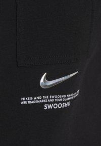 Nike Sportswear - Print T-shirt - black/white - 8