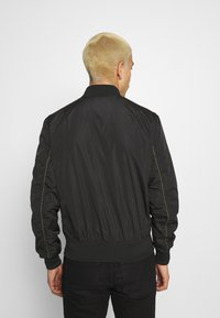 Alpha Industries - PARACHUTE - Bomber Jacket - black - 2