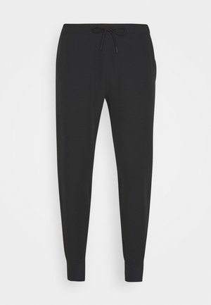 TRAVELER JOGGER - Trousers - black