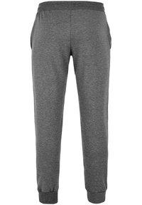 Reusch - Tracksuit bottoms - dark grey / white - 1