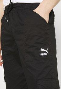 Puma - CLASSICS   - Cargo trousers - black - 4