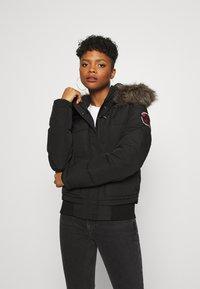 Superdry - EVEREST - Winter jacket - black - 0
