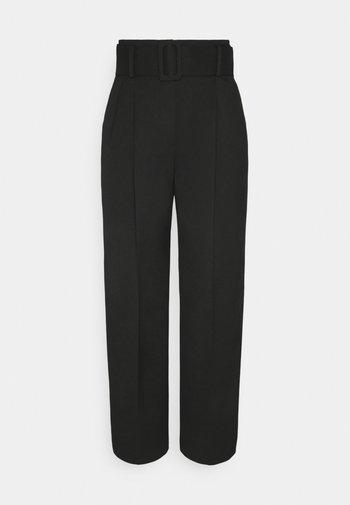 HUGESA - Trousers - black