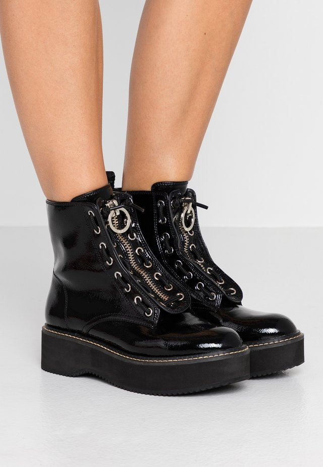 RHI LACE UP BOOT - Platform ankle boots - black