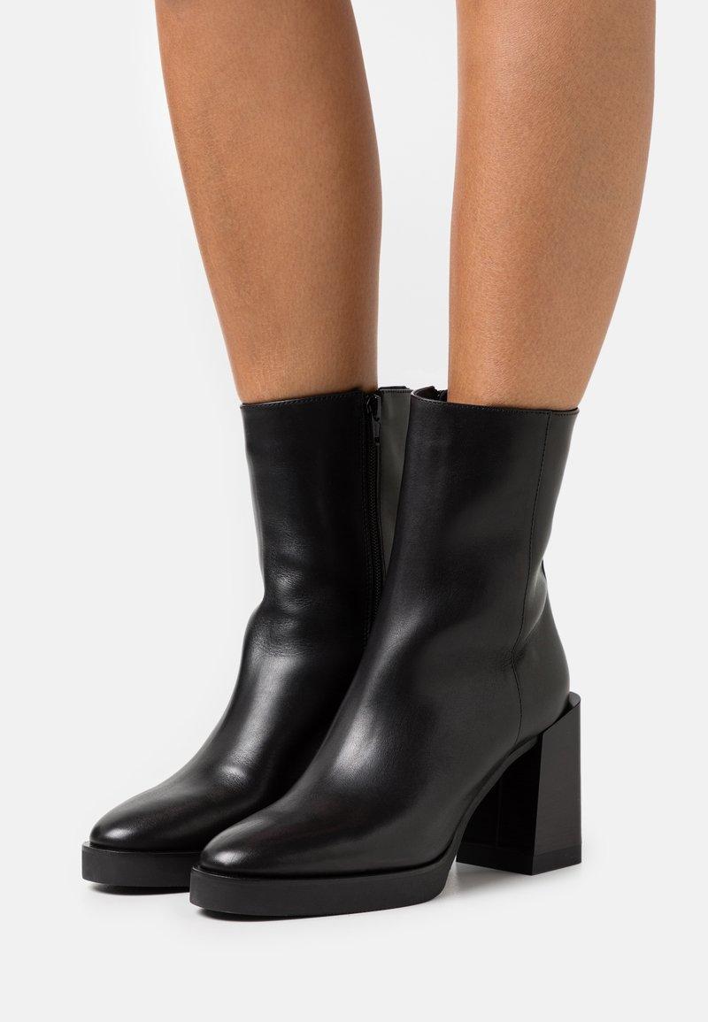 Furla - GRETA BOOT  - Platform ankle boots - nero