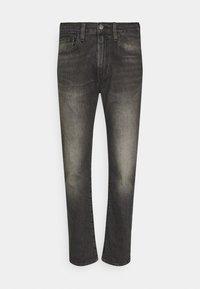 502 TAPER - Slim fit jeans - blacks