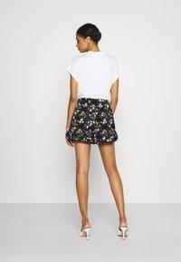 ONLY - ONLNOVA LUX FRILL  - Shorts - black/venus - 2