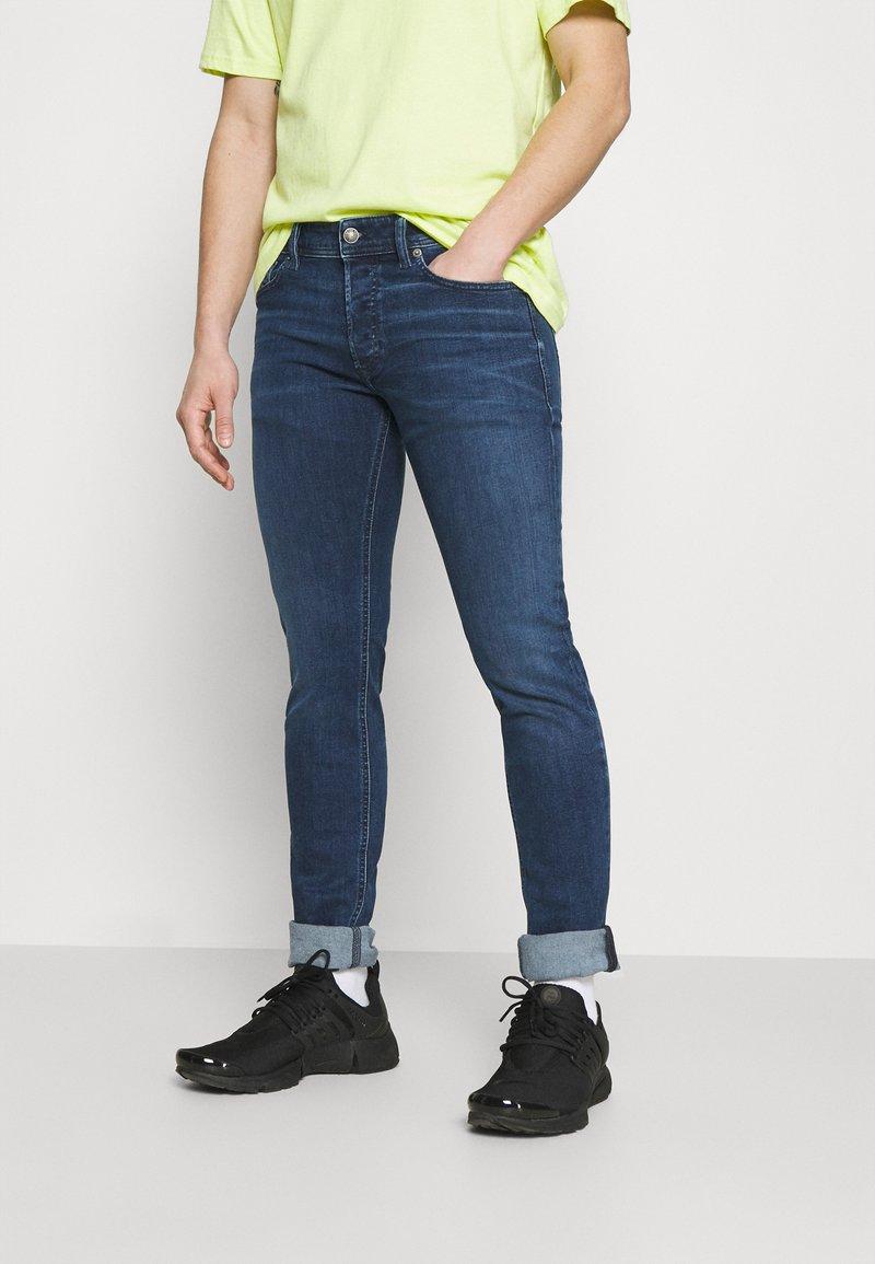 Diesel - SLEENKER - Jeans Skinny Fit - dark blue