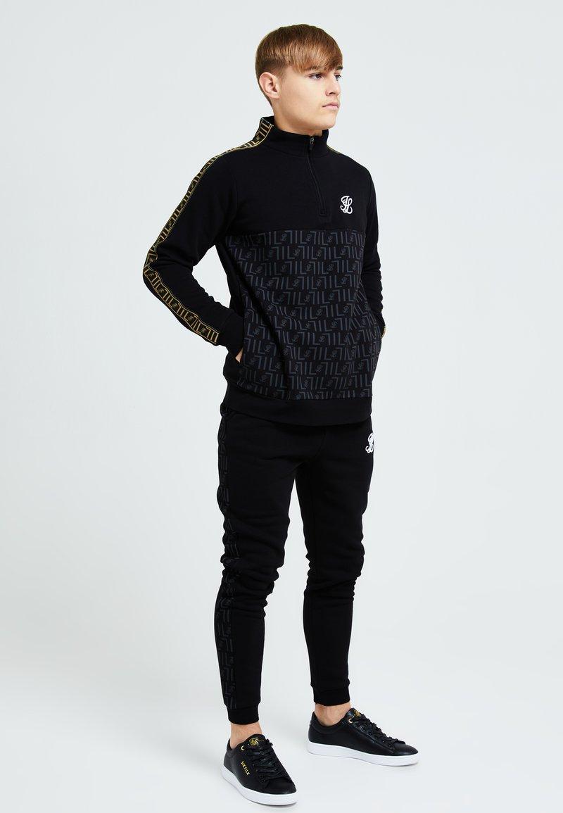 Illusive London Juniors - ELITE QUARTER ZIP - Collegepaita - black