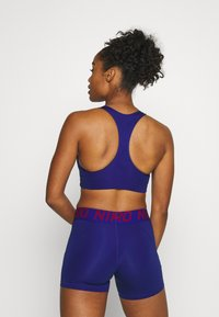 Nike Performance - BRA  - Sujetadores deportivos con sujeción media - deep royal blue/noble red - 2