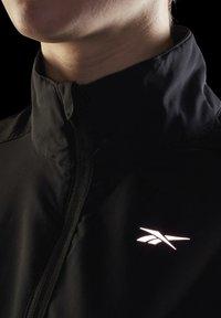 Reebok - RUNNING ESSENTIALS - Training jacket - black - 5
