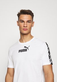 Puma - AMPLIFIED TEE - Print T-shirt - white - 3