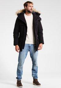 Napapijri - SKIDOO OPEN LONG - Zimní kabát - black - 1