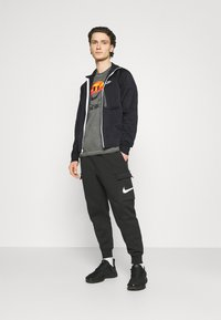Nike Sportswear - TRIBUTE - Träningsjacka - black/white - 1