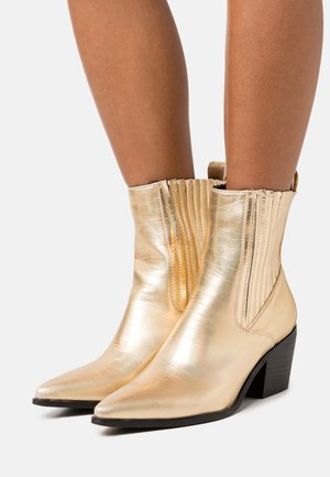 ROCCO - Cowboy/biker ankle boot - gold holographic
