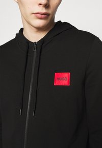 HUGO - DAPLE - Zip-up hoodie - black - 5