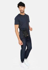 Eastpak - BUDDY  - Across body bag - black - 0