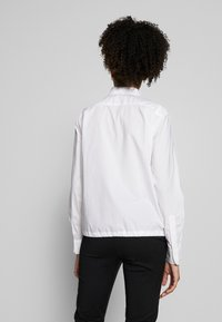 Marc O'Polo - BLOUSE LONG SLEEVEED TIE DETAIL AT HEM POCKET - Button-down blouse - white - 2