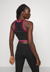 The North Face - WOMENS ACTIVE TRAIL TANKLETTE - Sports shirt - pink/black - 2