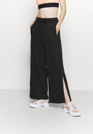 WIDE LEG SPLIT SEAM PANTS - Pantalones deportivos - black