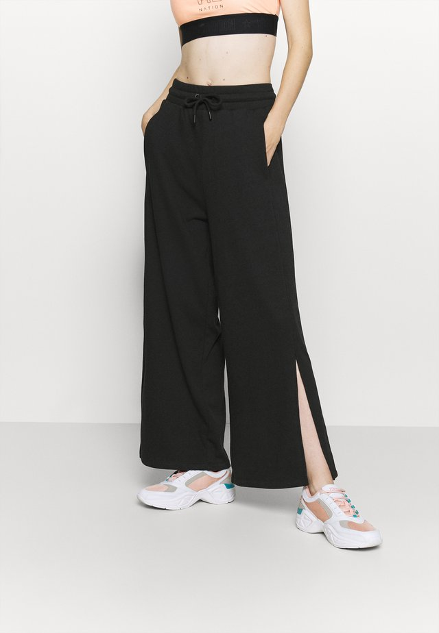 WIDE LEG SPLIT SEAM PANTS - Tracksuit bottoms - black
