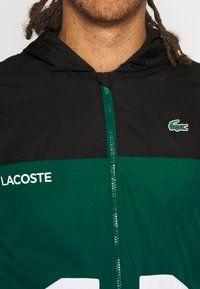 Lacoste Sport - TRACK JACKET - Training jacket - black/bottle green/white - 4