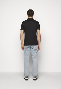 Michael Kors - SLEEK - Polo shirt - black - 2