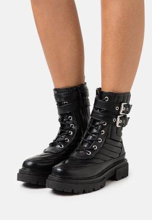 BRIANAH - Platform ankle boots - black