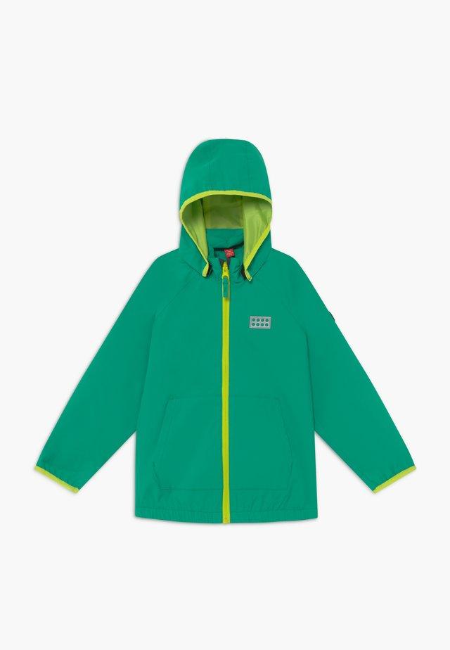 LWJULIO 200 JACKET - Waterproof jacket - green