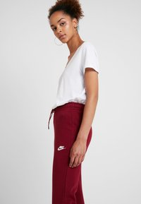 Nike Sportswear - PANT TIGHT - Tracksuit bottoms -  red - 3
