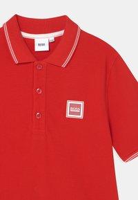 BOSS Kidswear - Polo shirt - bright red - 2